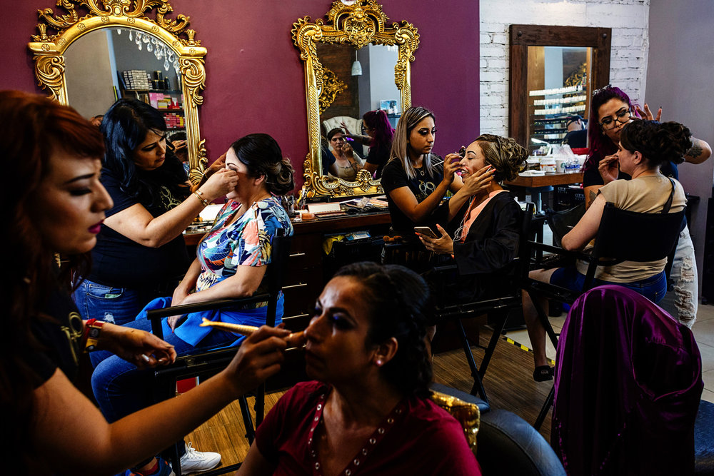 Four ladies getting their make-up done at Joel beauty salon, before the wedding ceremony.