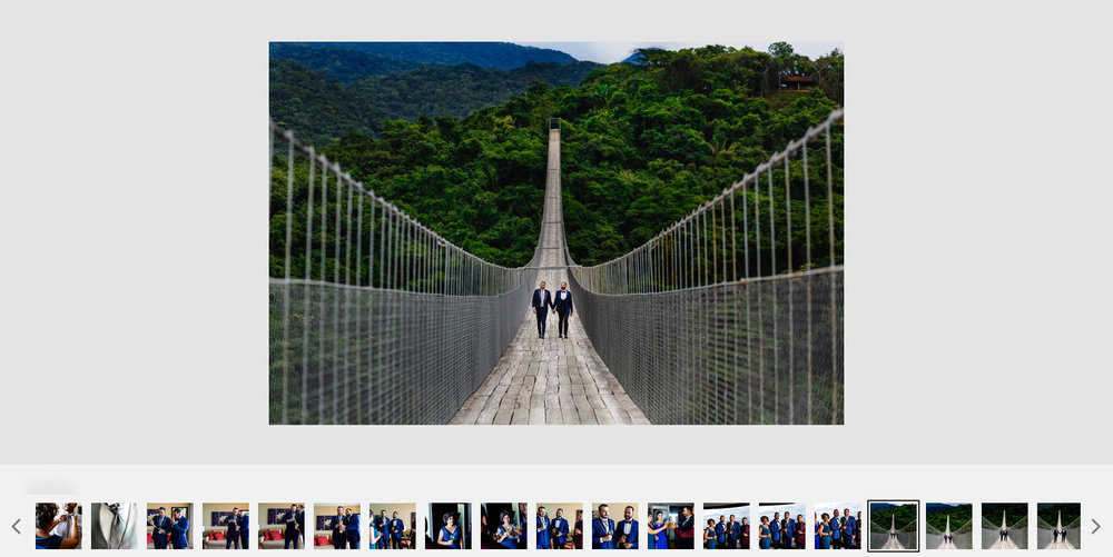 Gay couple walking over the Jorullo bridge at the Canopy River Park up in the Sierra Madre near Puerto Vallarta.
