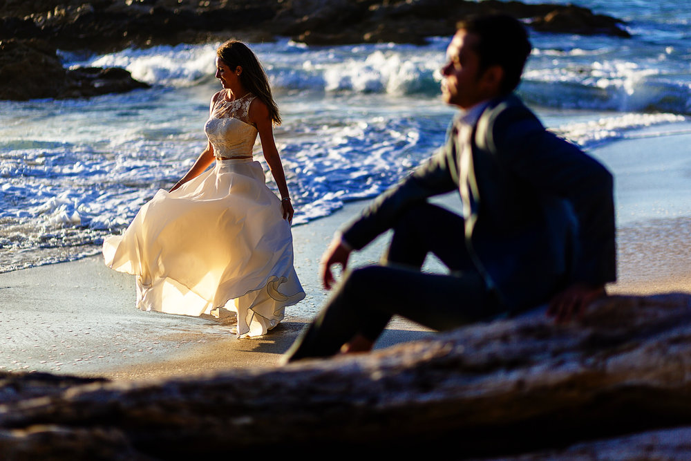 Bride and groom portrait on the beach for their trash the dress session.