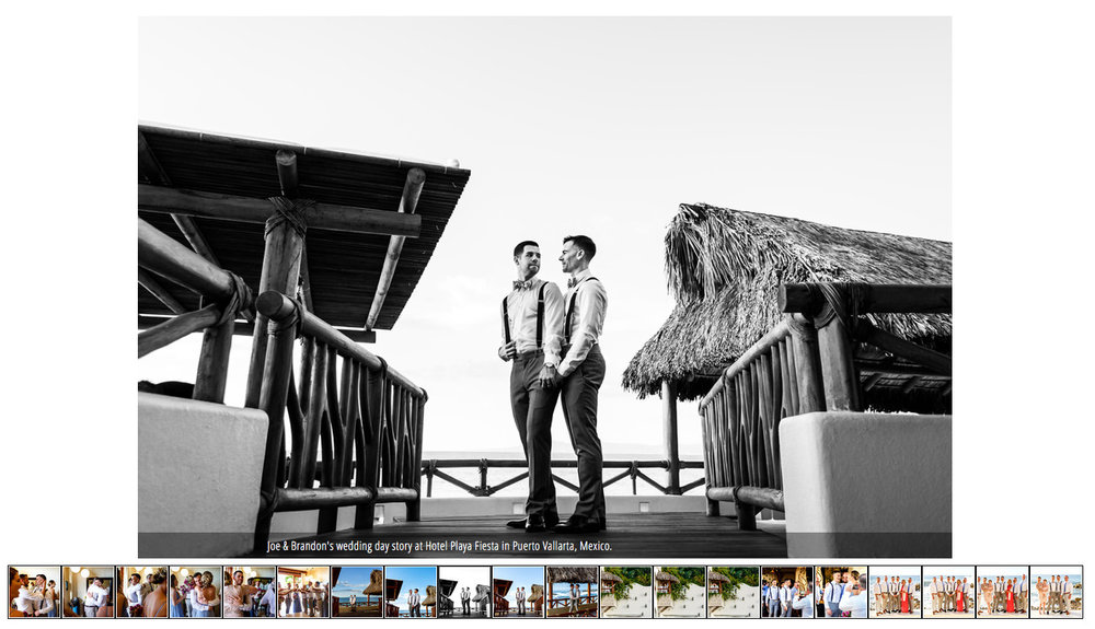 Gay couple posing over a wood bridge in black and white.