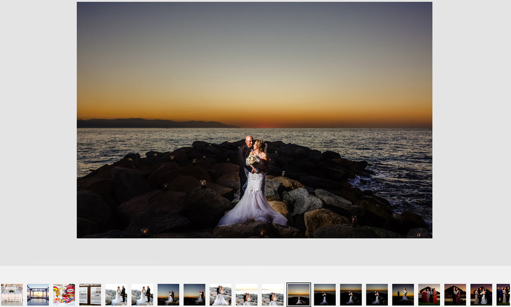 Bride and groom together over the rocks near the pacific ocean in Mexico under the blue-gold romantic sunset.