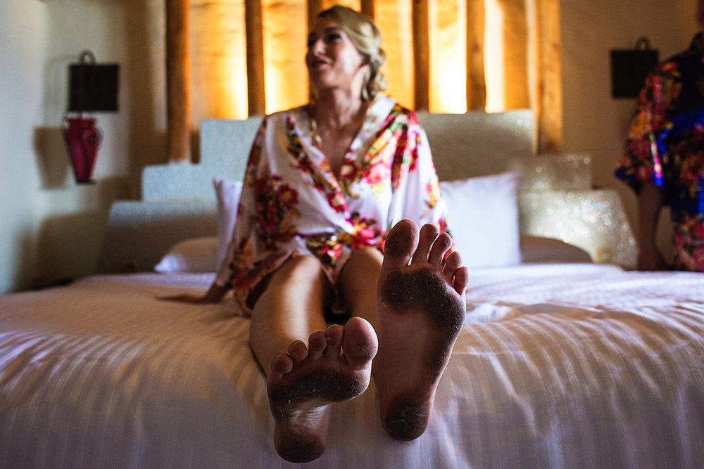 wedding-bride-dirty-feet-robe-amazon-playa-fiesta.jpg