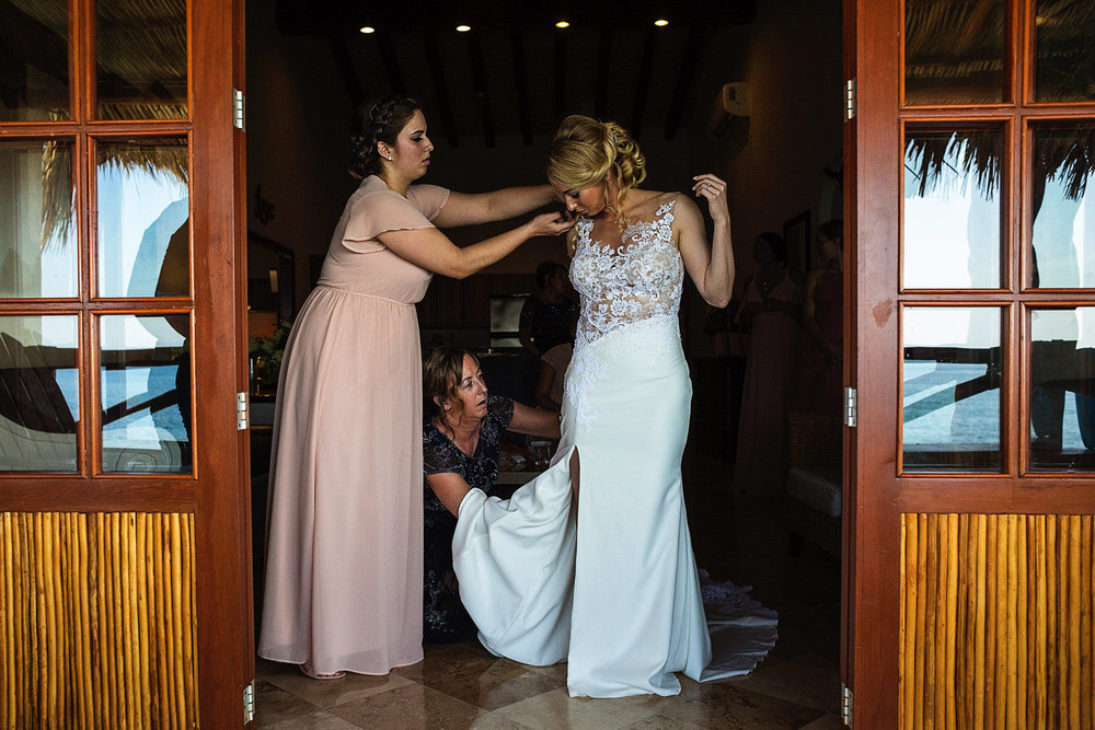 bride-mother-bridesmaid-getting-dressed-playa-fiesta-wedding.jpg