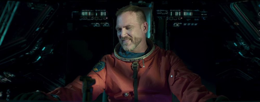Ty Olsson as Ethan Kane