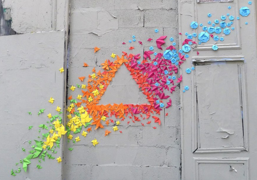 Hundreds of colorful origamis are gathered together to create unique patterns