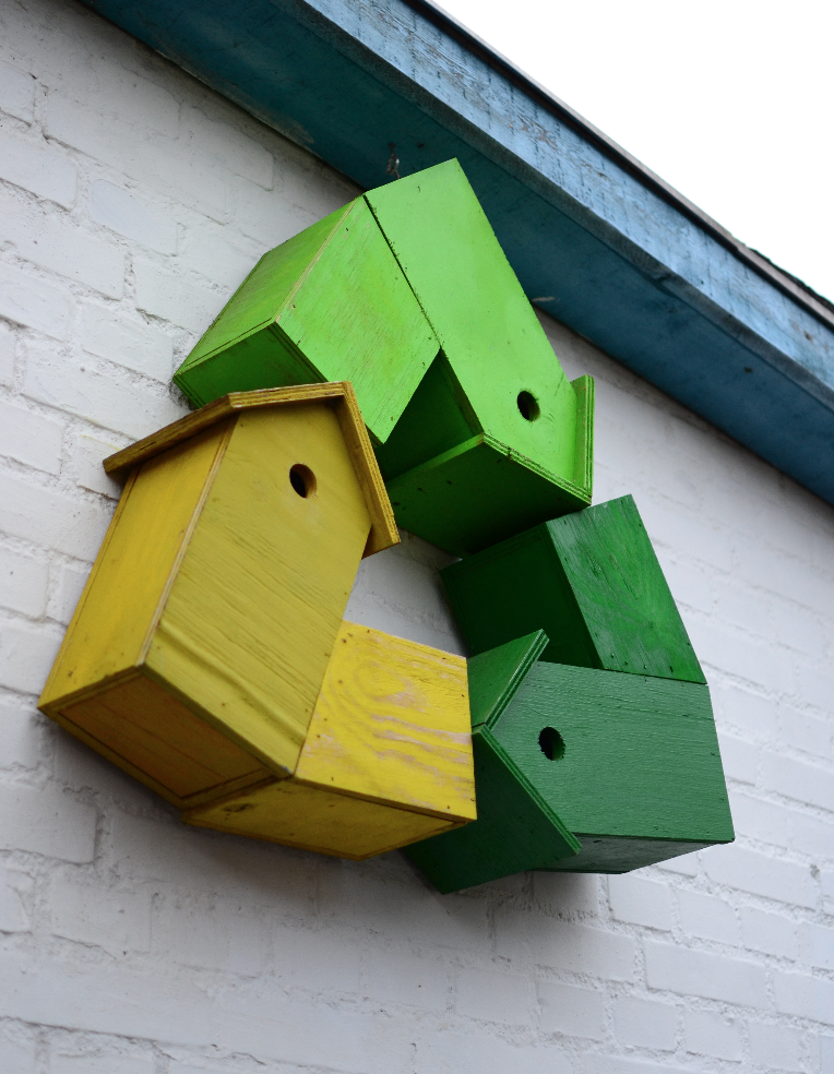 He gives a second life to old wood by building bird houses with it