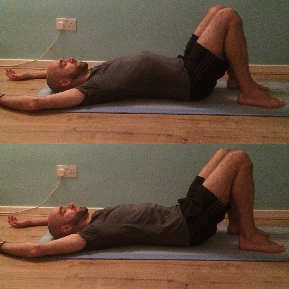 Pelvic tilts: 10 rounds, working with breath Lie on your back with your knees bent and the soles of your feet flat on the floor. As you inhale gently press the tailbone down into the mat to arch the lower back away from the floor. As you exhale flatten and spread the lower back into the earth, taking a slight tuck of the tailbone towards the back of the knees. It's a subtle movement that gently mobilises the pelvis.