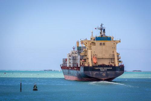 Container ship leaving Dar es Salaam port c. Lspencer / Shutterstock.com