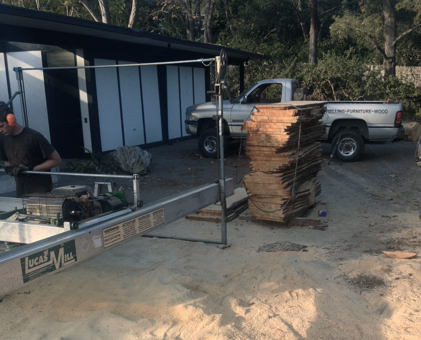 A handful of overgrown and over-planted pines were removed from the project site.  The wood is milled with a portable saw and will be stacked, dried, and used for fencing, steps, benches, and tabletops throughout the exterior and interior remodel.