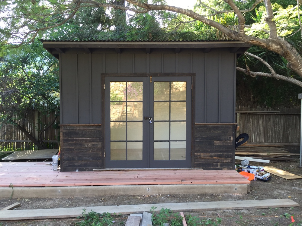 a multi-purpose shed nearing completion in rob's garden.  painting studio, sleeping shed, lots of possibilities.  salvaged materials from rmla projects including doors/windows from historic Cate school building, black-stained redwood siding from Lutah Riggs project, and hand-me-down cedar and redwood from Lynn Morris.