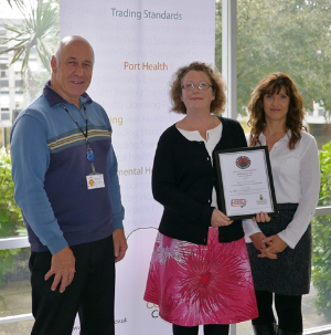 Lisa and Jo collecting their Buy With Confidence Award from Cornwall Council's Geoff Brown.