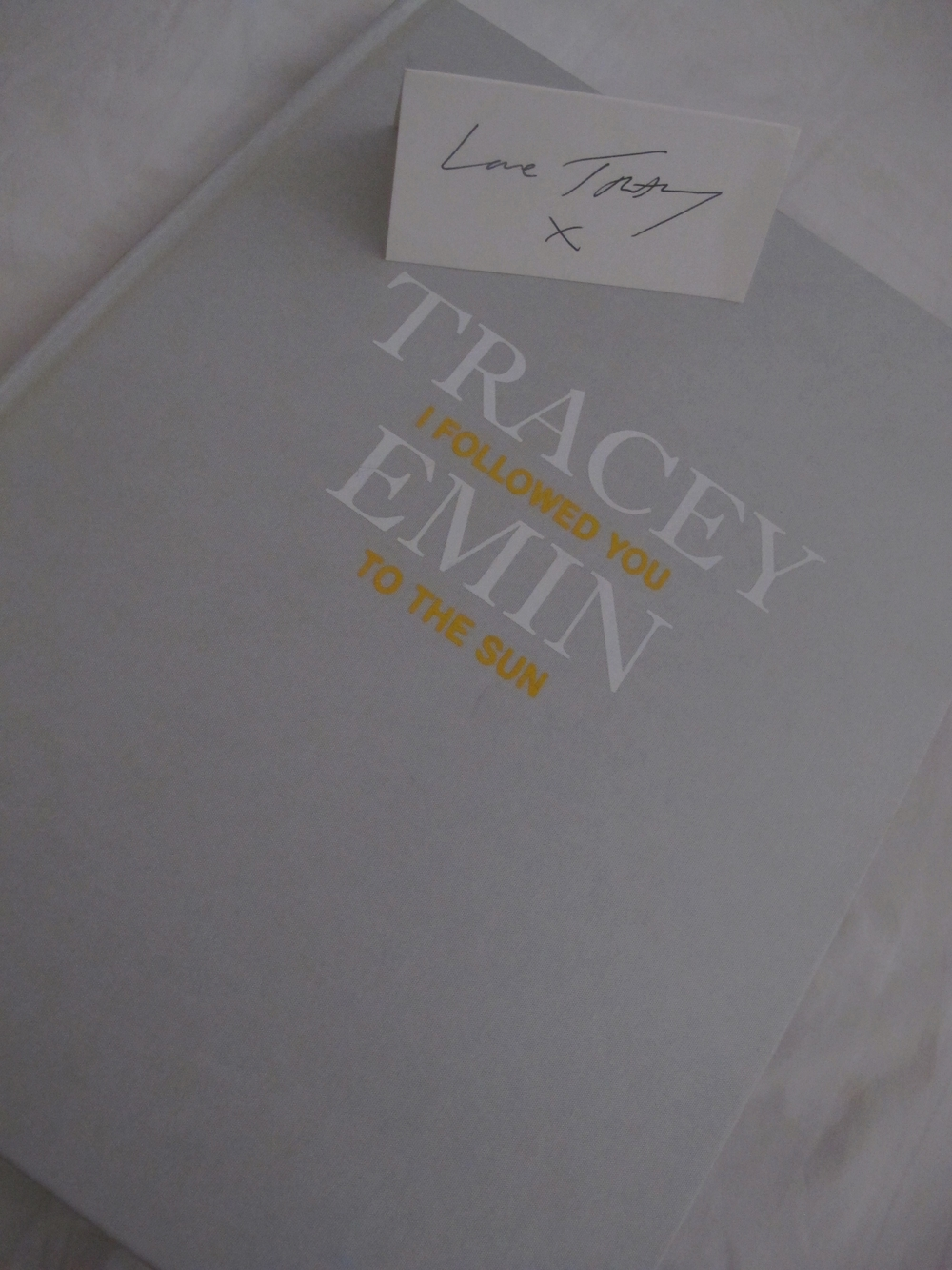 Each of us got a book of the show and our place holders in the table were signed by Tracey on the back