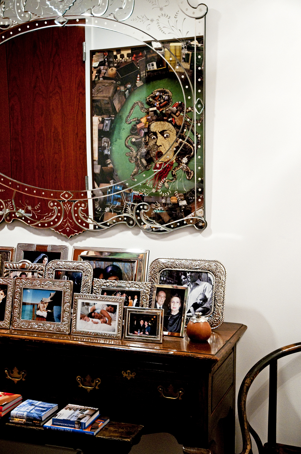 """A Vik Muniz piece from an edition of 6 called """"Medusa After Caravaggio"""" from the """"Junk"""" series is reflected on a Venetian mirror in my foyer."""