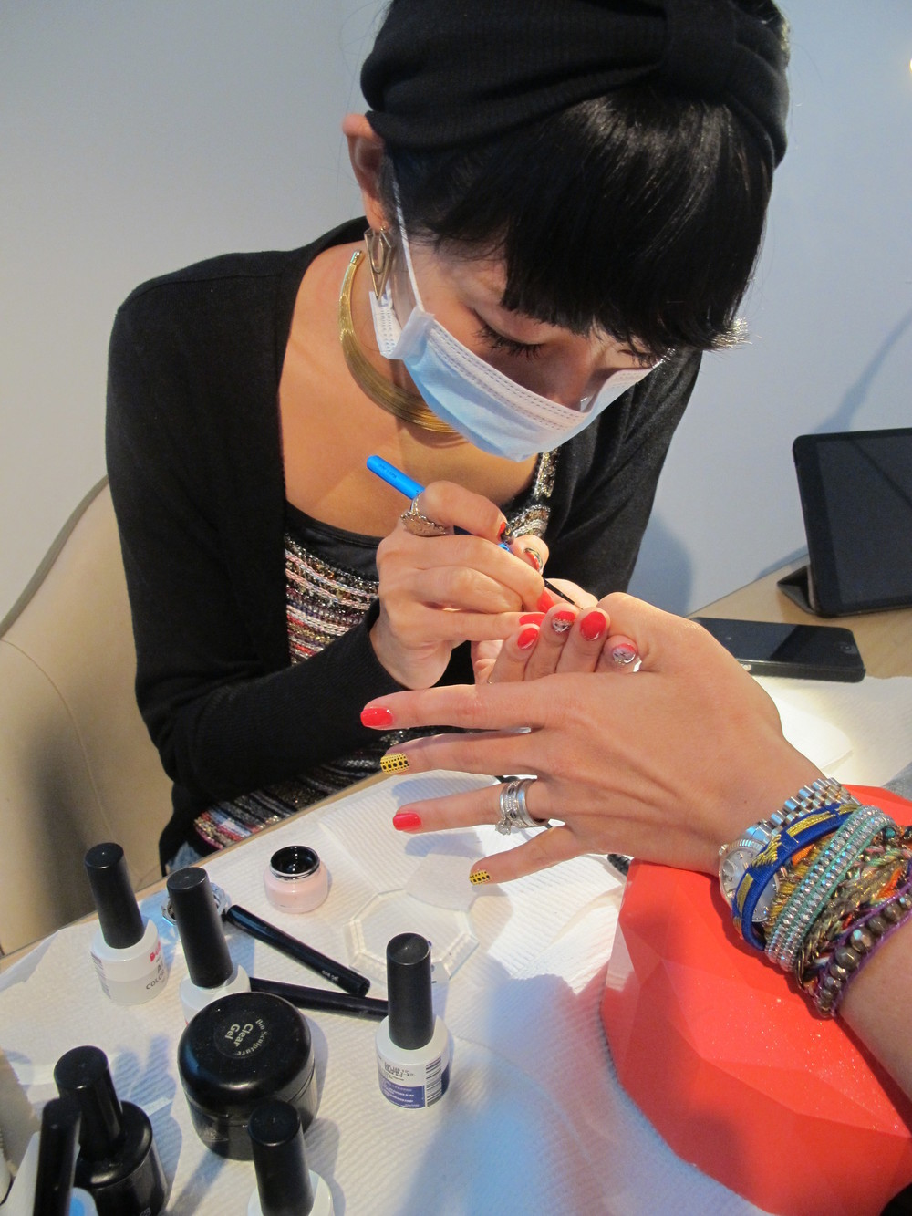 The super talented Hana working on my nails, dot by dot - no stickers here