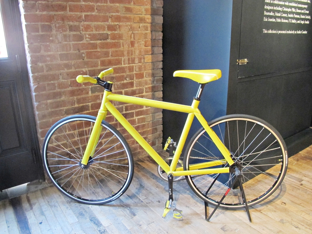 This is a limited edition bike upholstered in yellow leather.  It was designed by Pharrell Williams for Domeau & Pérès.