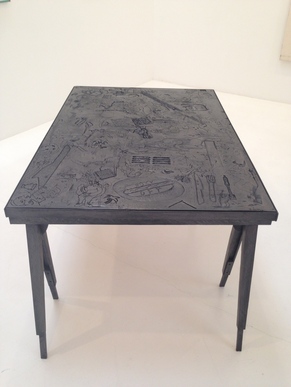 Lukas Geronimas's carved table