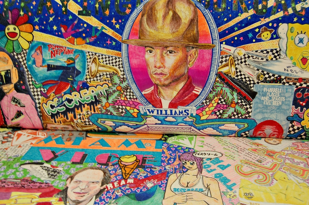 A detail of the Rob Pruitt hand-painted loveseat that includes biographical and sentimental images related to Pharrell's life