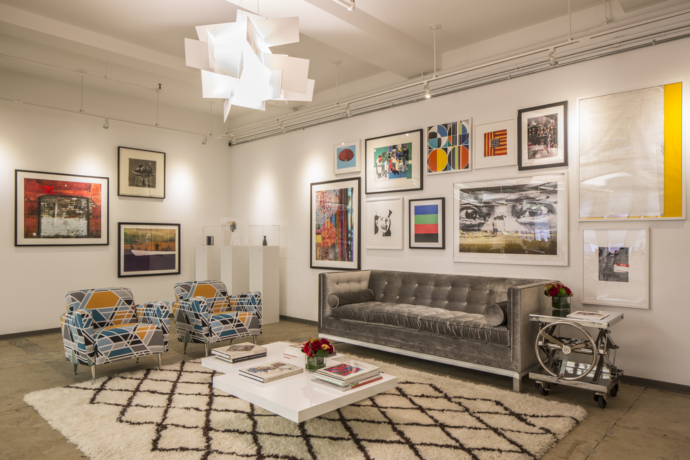 The lounge area where all the limited edition prints on the wall are by Artspace in collaboration with artists such as Assume Vivid Astro Focus and Alex Katz.  The chairs were reupholstered using Sarah Morris's geometric fabric.