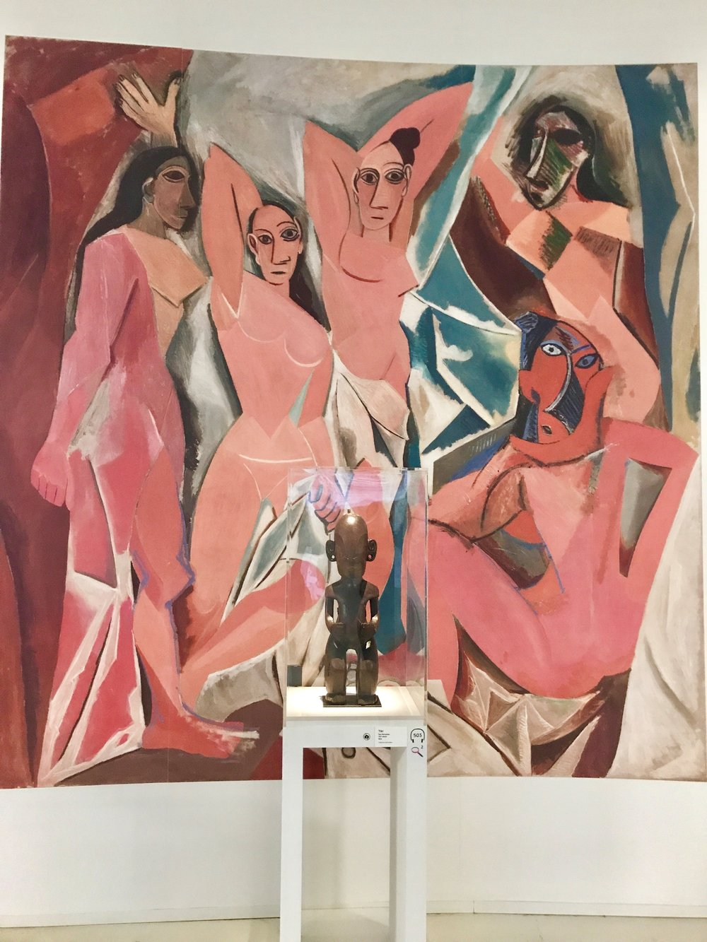 A reproduction of  Les Demoiselles d'Avignon  with the original Tiki sculpture that Picasso first bought for himself in 1910.