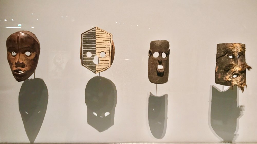 Pablo Picasso, Masque, 1919, is the second from the left, surrounded by African and Indonesian masks from the 20th Century.