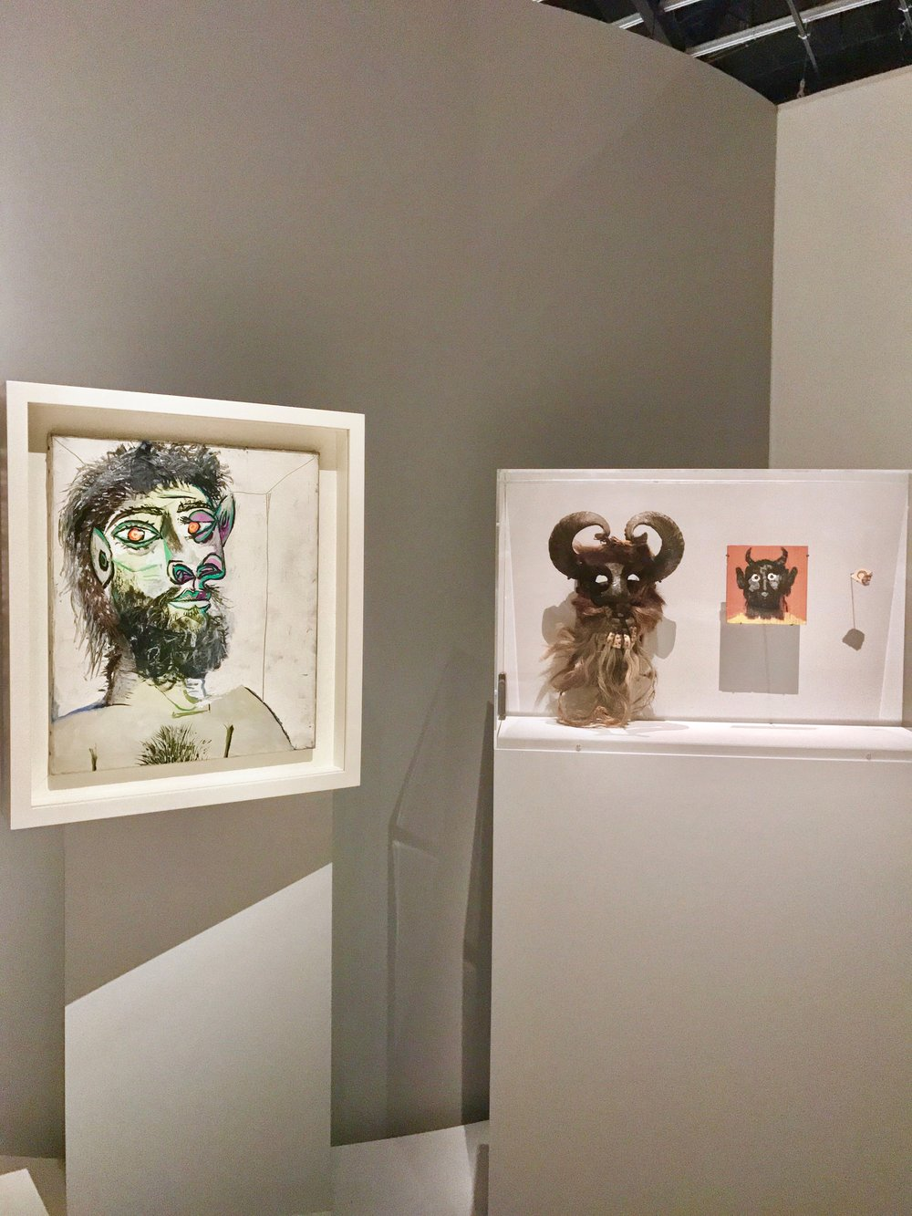 Pablo Picasso,  Tê  te d'homme Barbu, 1979,  Mexican Mask from the 20th Century and Pablo Picasso,  Carreau Industriel Dècorè au Verso d'une Tête de Faune,  1961.