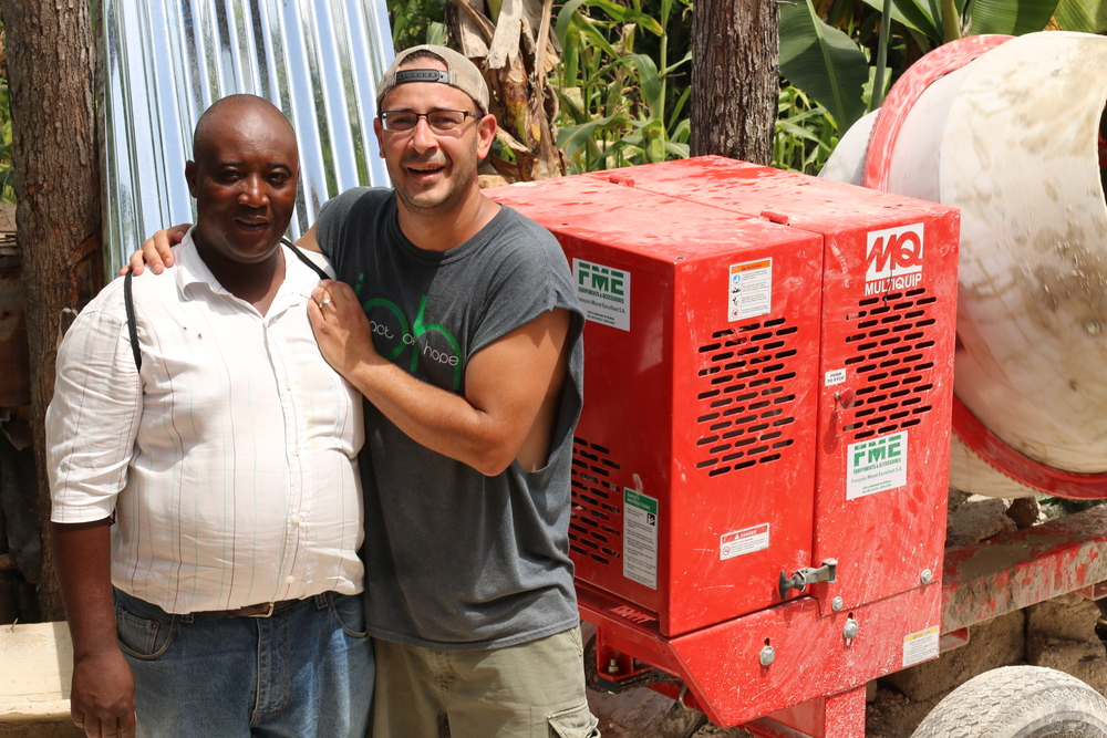 On June 9th of 2014, Joel Troyer and Foundations of Hope Ministries was honored to present Pastor Echelette Charle of First Baptist Church in Calebasse, Haiti with a new Multiquip cement mixer. This mixer will be a vital asset in home construction as well as provide an income for Pastor Echelette and his construction crew.  Working alongside A Door To Hope ministries of Nashville, TN whose funding has increased new home production in Calebasse, FOH is multiplying the gifts and efforts of both ministries.  It is the goal of FOH to equip the local construction crews in villages throughout Haiti as well as other areas of the developing world with new mixing equipment to provide proper concrete construction and get the shovels off the ground. By empowering pastors in the developing world, FOH can help provide a hand-up to local churches and help enable them to provide for themselves as well as their communities. To view the latest video, filmed by Eclectic Brew Productions, click below...