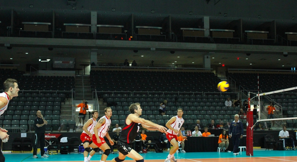 Canada's Indoor Men's Team playing in front of a mostly empty stadium.