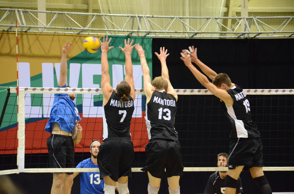Manitoba goes for the triple block during their 3-0 loss to Quebec on Day 1