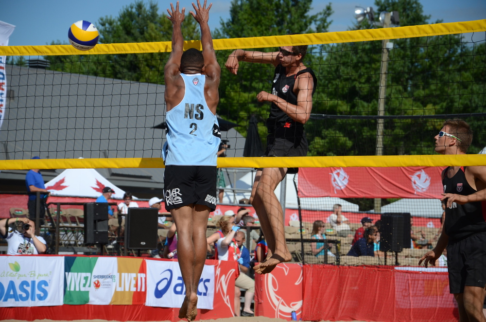 Fiodar Kazhamiaka of Ontario gets the ball past Justin Brooks of Nova Scotia in Day 1 action