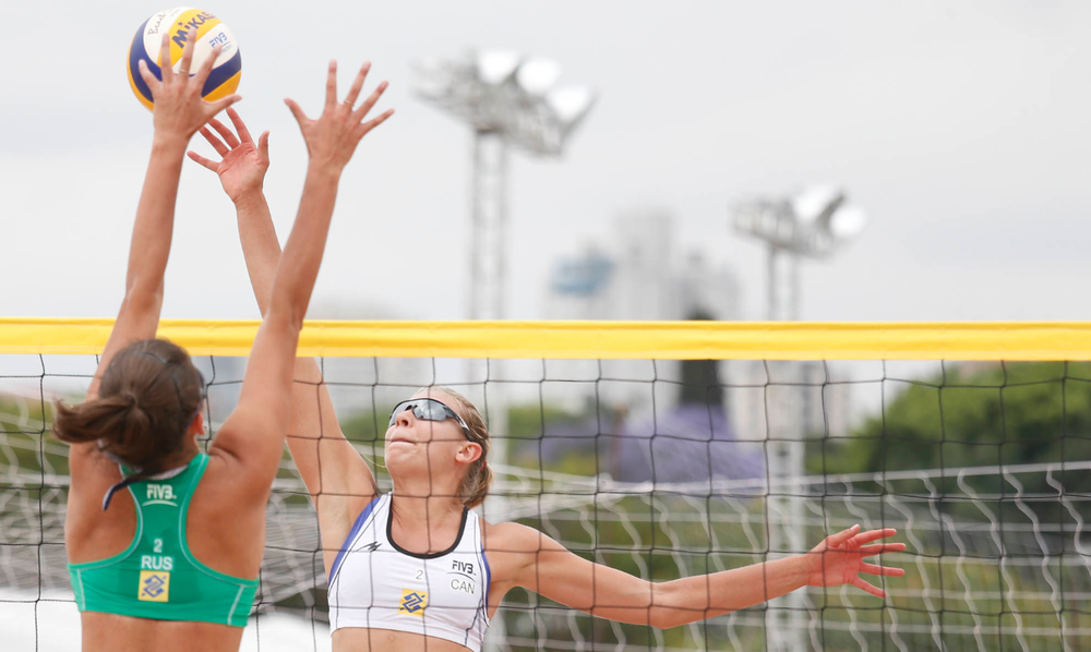 Kristina Valjas wipes off the block in Sao Paulo. Photo: FIVB.