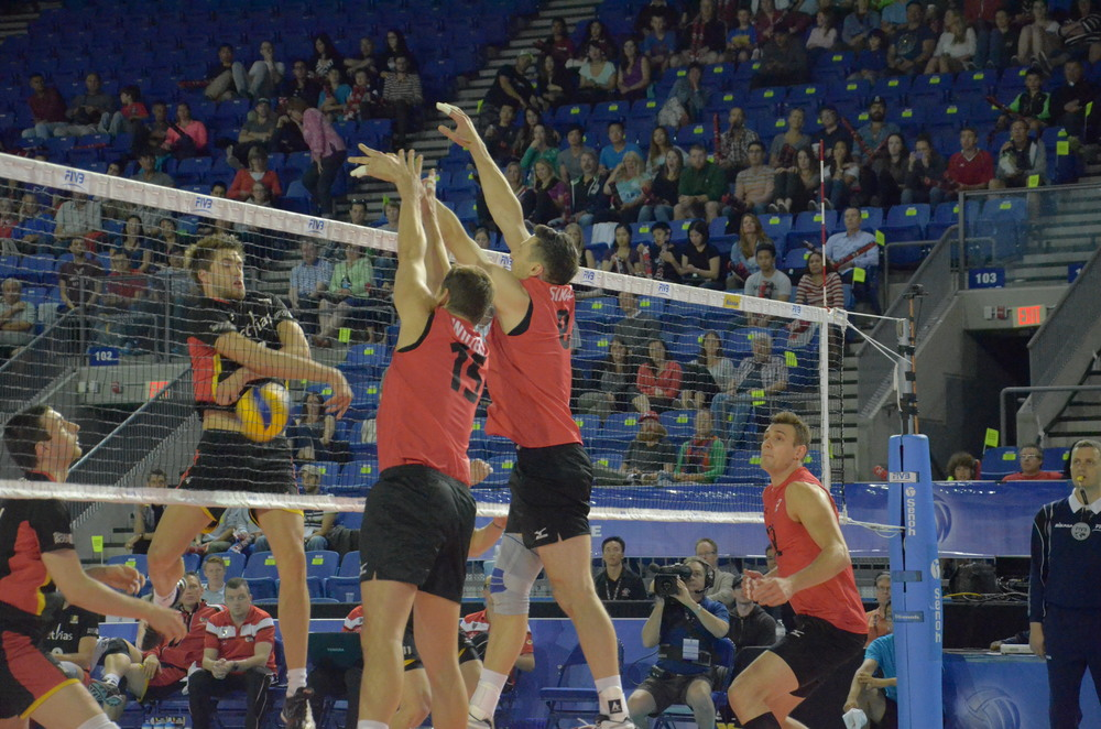 Adam Simac recording one of his four blocks in Canada's 3-0 over Belgium  Photo: Everett Delorme