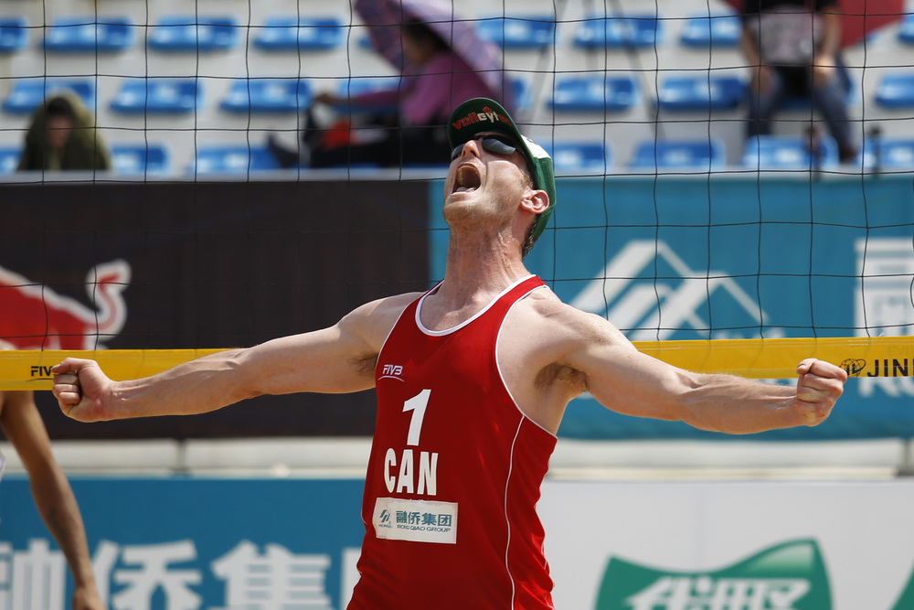 Josh Binstock celebrates a point during their win over Russia. Binstock/Schachter finished 5th in Fuzhou.  Photo: FIVB