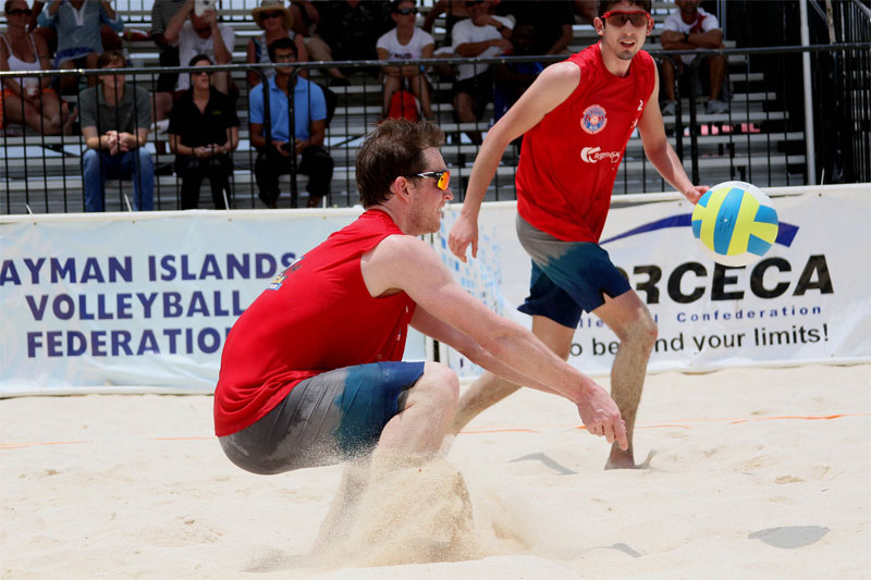 Christian Redmann passes the ball to Felipe Humaña-Paredes in pool play during the NORCECA Grand Cayman tournament  Photo: NORCECA