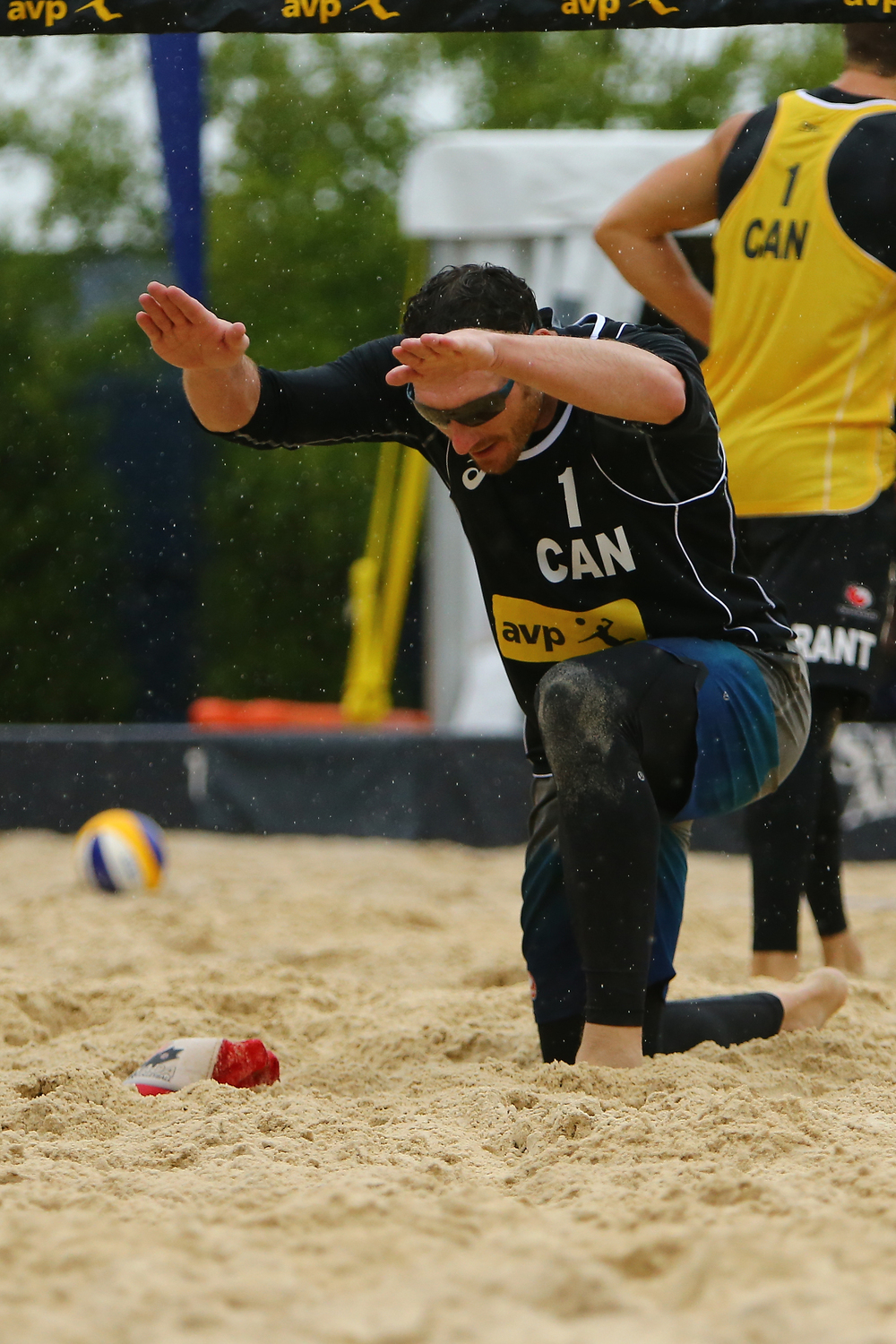 Josh Binstock bows to his partner Sam Schachter during their match against Grant O'Gorman (background) and Sam Pedlow.  Photo: FIVB