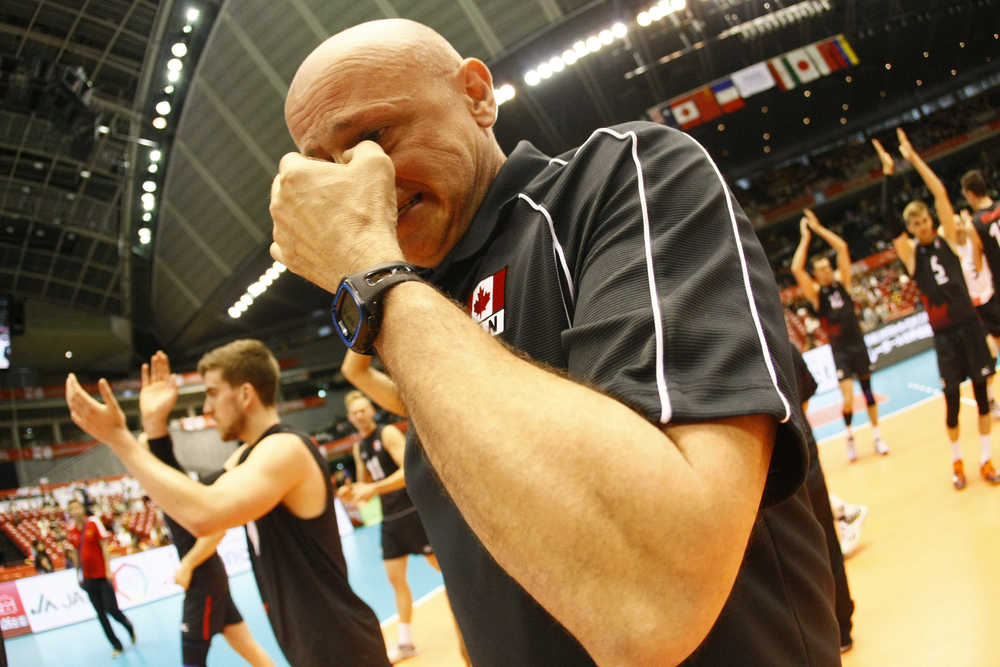 An emotional Coach Hoag after the win  Photo: FIVB