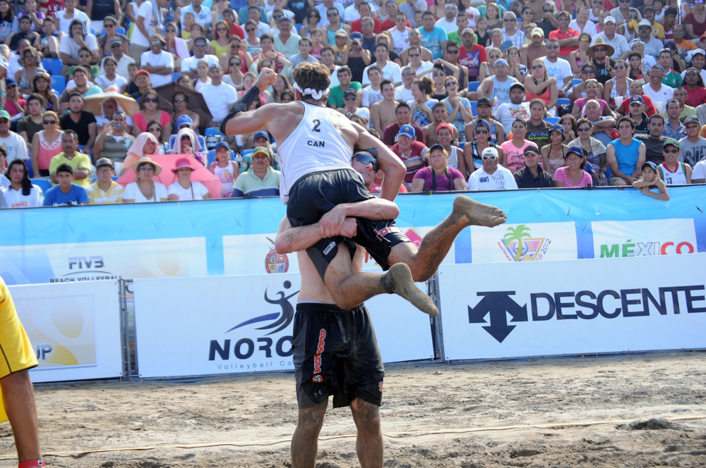 Martin Reader and Josh Binstock celebrate a win at the NORCECA Continental Cup in 2012. Photo: FIVB