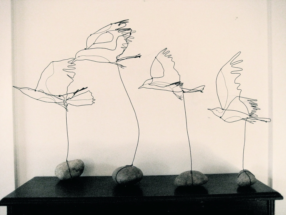 Wire birds on rocks
