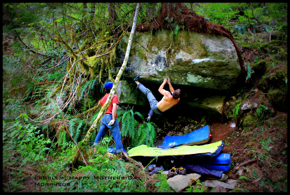 Happy Mothers Day-V8  Morpheus Bouldering Area  FA Miles Berkey  Begin on the left with a toe hook and bust up to the reachy ledge!  A trail side boulder with fun and challanging movements.    Pictured: Miles Berkey on the problem, Pablo Zuleta on Spot.