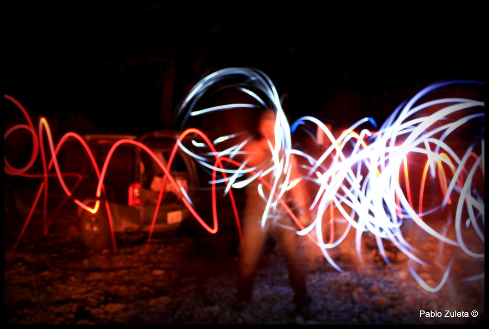 Miles, Cole, Pablo, Ben Shrope, and Melanie light painting around the camp fire.