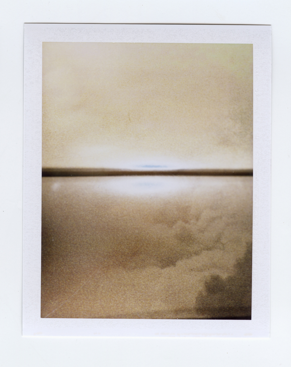 centerfold (everlasting sunset)  Polaroid of found National Geographic, 2015   Statement + Info