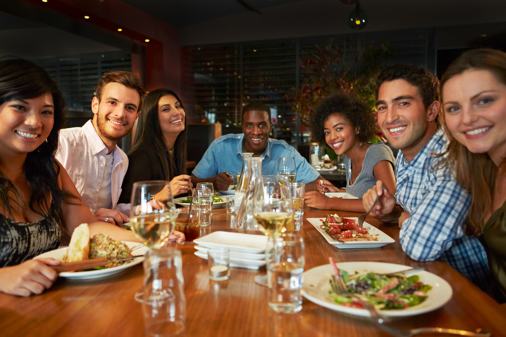 photodune-11161400-group-of-friends-enjoying-meal-in-restaurant-m.jpg