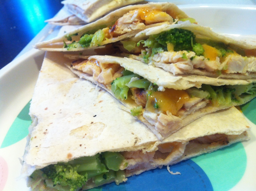 Dinner. Flour tortillas, cheddar cheese, small slices of chicken, broccoli. Organic goodness makes me smile.