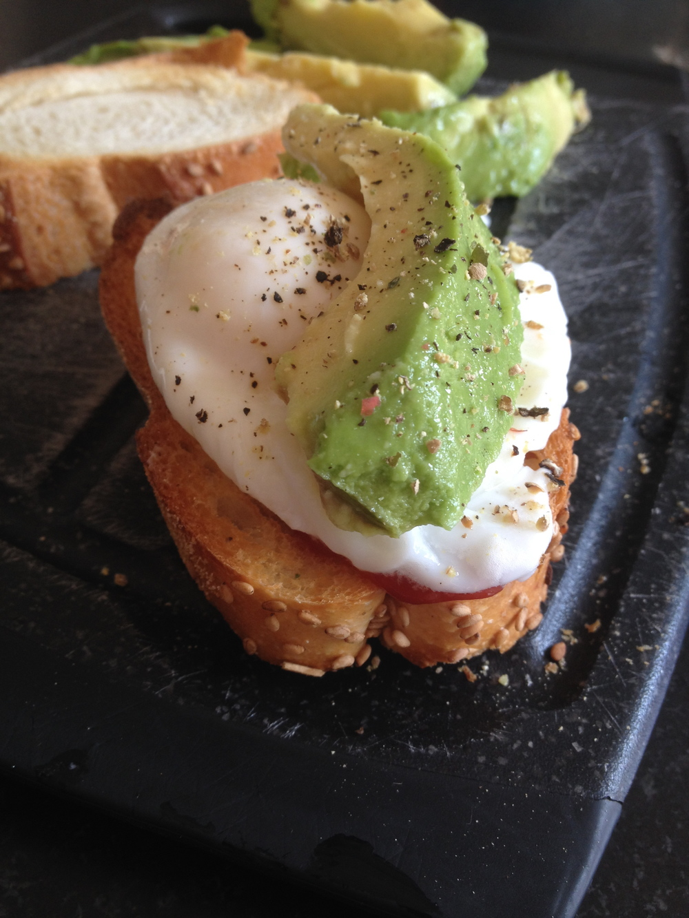 Meal Idea: One poached egg on top of a slice of tomato with some avocado on top. Add some s&p if you like. Try to keep this on whole grain toast to keep the glycemic index low (notice I gave in to the delicious white italian bread).