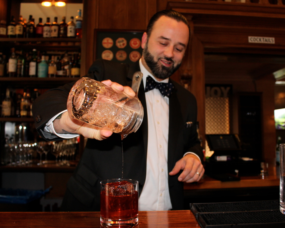 Christopher James mixing an Old Fashioned at The Vail Bar
