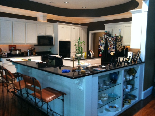 Above photo: Kitchen (before) with peninsula cabinetry that made the kitchen feel isolated