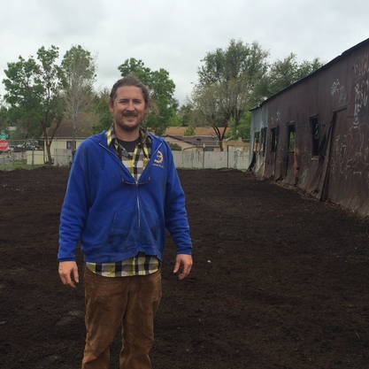 Josh Sampson digs into the soil at the Westwood Food Co-op