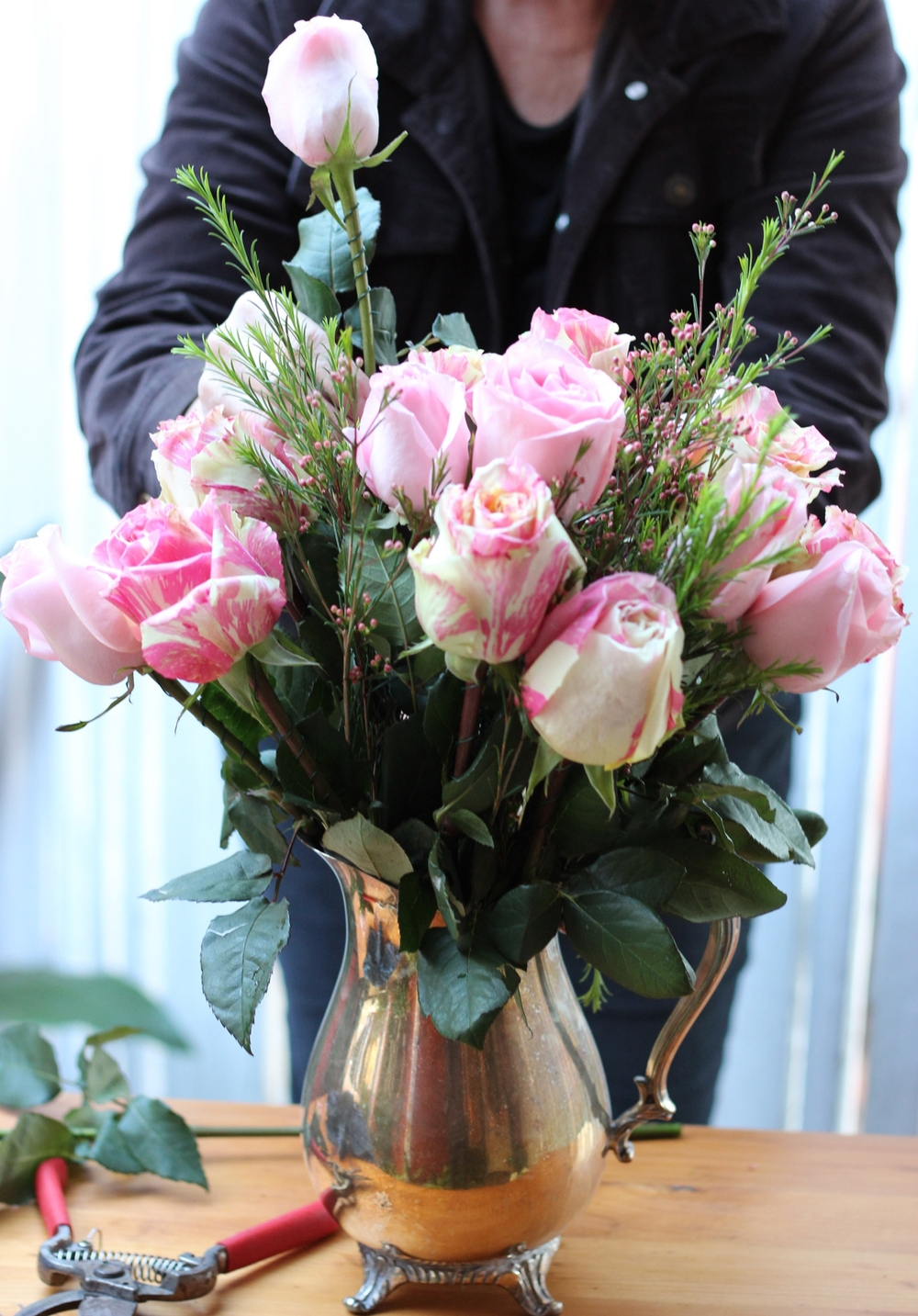 Next, add the all pink roses to create a full bouquet.