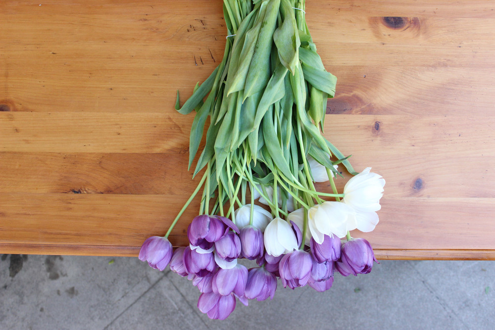 You need 2 doz. violet tulips, 1 doz. white tulips.