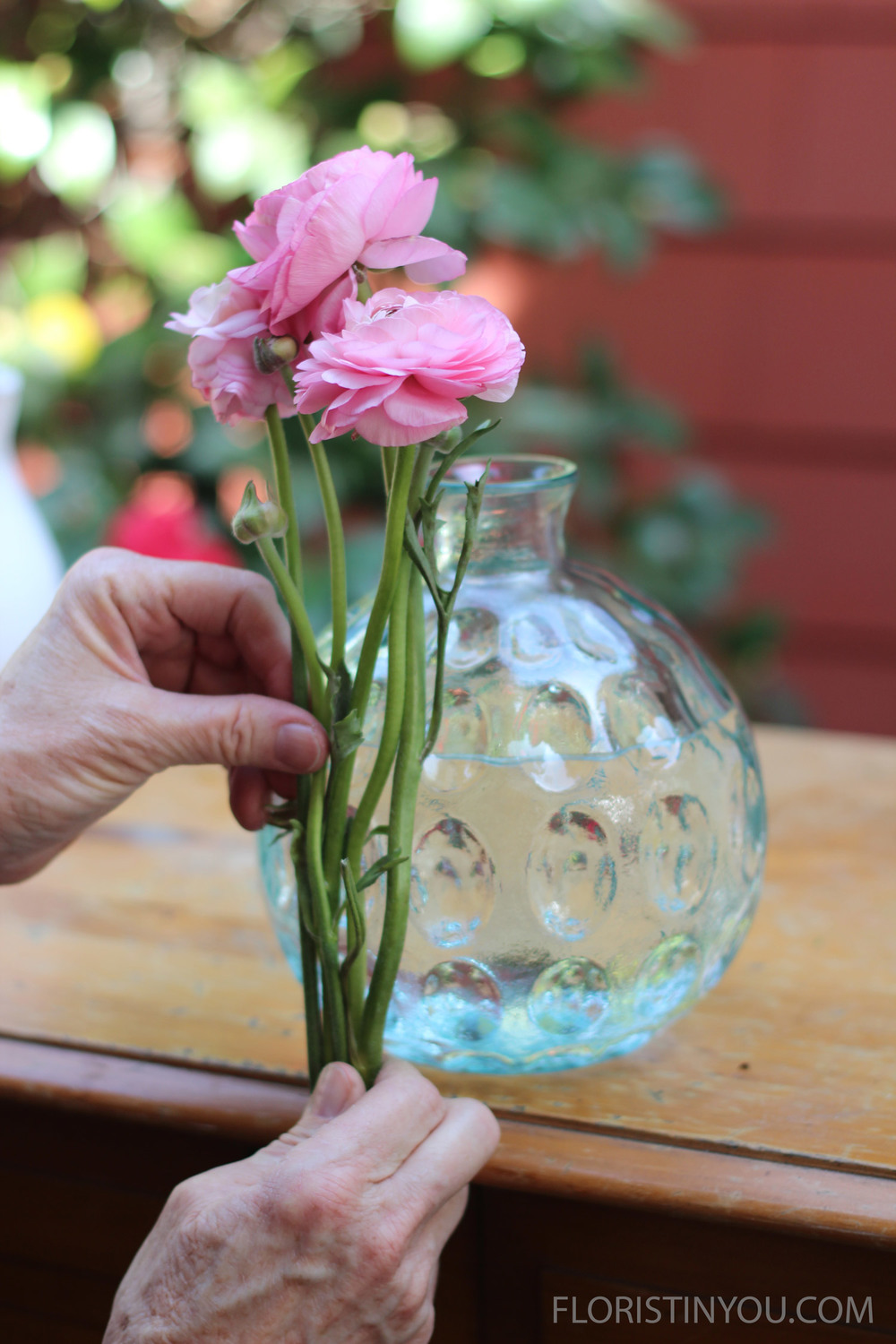 Use the vase as a reference for how short to cut the stems.