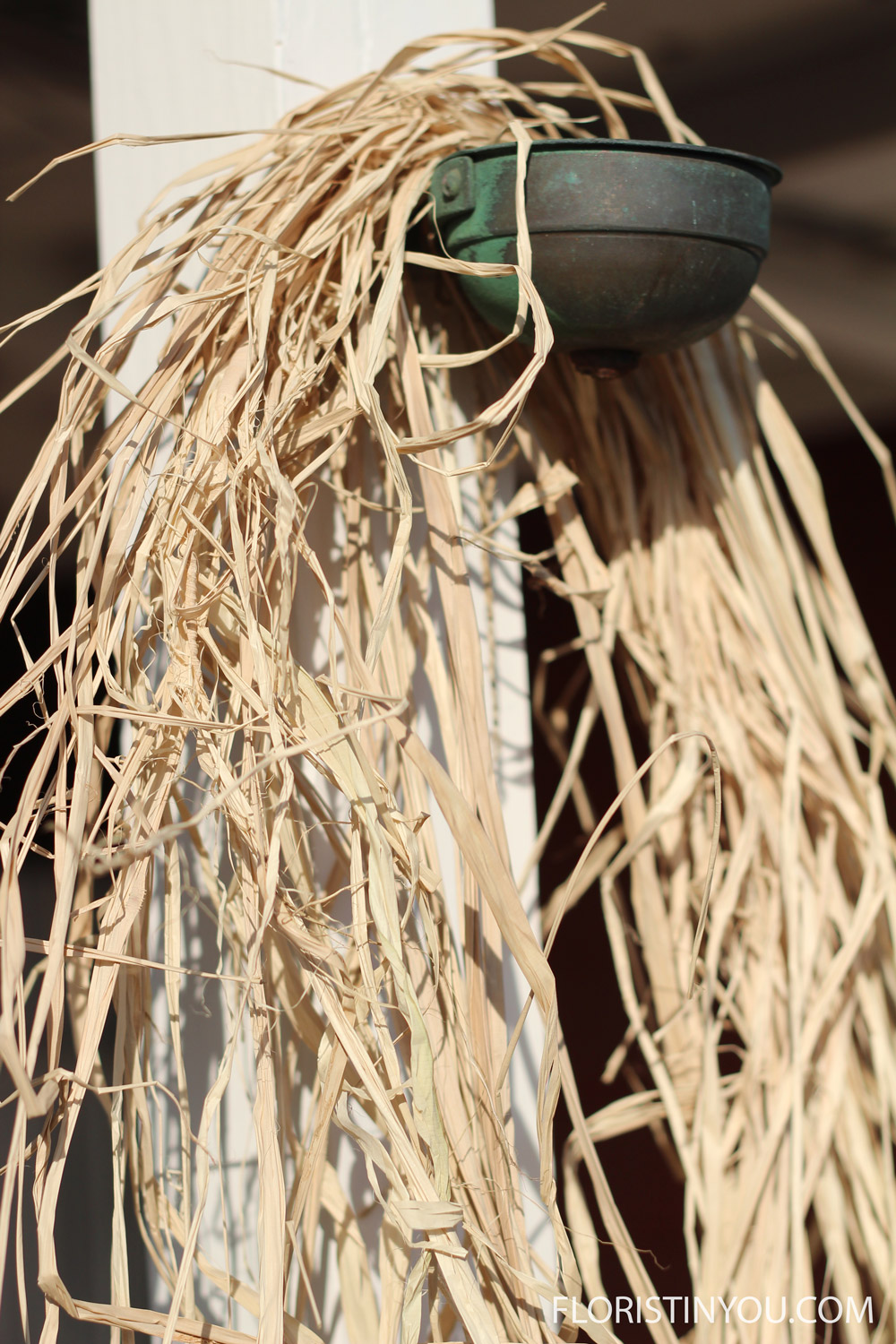Take raffia out of bag.  Hang it on a hook, or over something.
